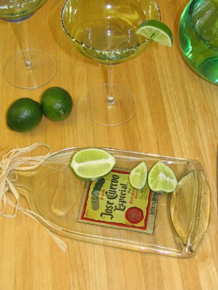 flatten plastic bottles to make awesome small board or serving trays ...